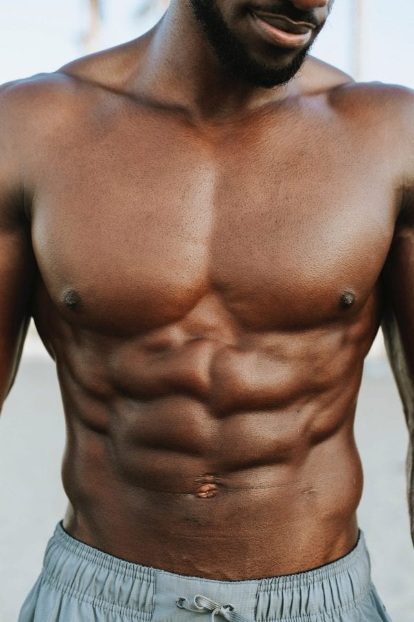 A man showing his six pack, 6 pack muscles, I want a six pack